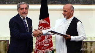 US hails Afghan power deal, seeks quick security pact